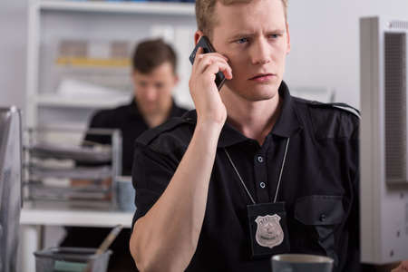 Police officer is talking on mobile phone