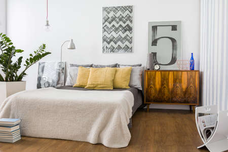 king size bed: Picture of stylish cozy bedroom with new furniture