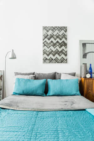 king size bed: Picture of matrimonial bed with light blue bedding Stock Photo
