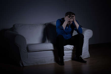 tiresome: Frustrated miserable man having a big dilemma Stock Photo