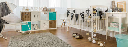 baby room: Cute and spacious room for little boy Stock Photo