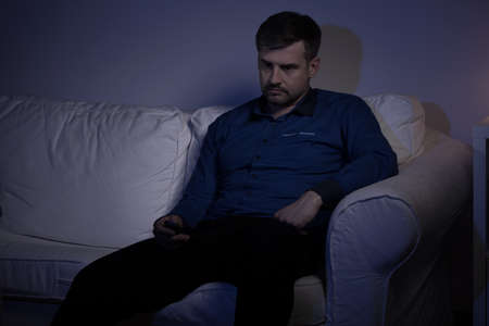 alcoholic man: Lonely depressed man sitting on the sofa Stock Photo