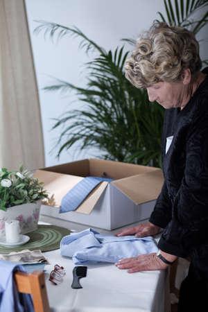 longing: Elderly widow longing for the dead husband