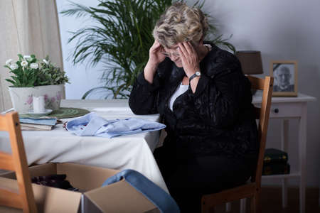 depressed woman: Mature widow crying over the loss of her husband