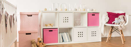 babygirl: White furniture in cute minimalism baby-girl room Stock Photo