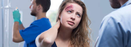 gash: Young woman has deep cut on forehead Stock Photo