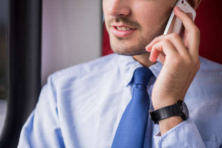 businessman phone: Close-up of businessperson being on the phone