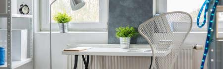 Close-up of desk in contemporary teen room Фото со стока