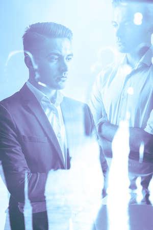 multiple exposure: Multiple exposure of casual and elegant businessman