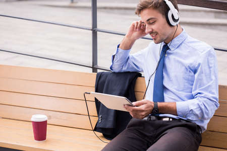 listening to people: Businessperson listening music and waiting for somebody Stock Photo