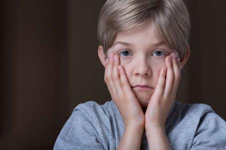 schoolchild: Portrait of sad blonde schoolchild - horizontal view