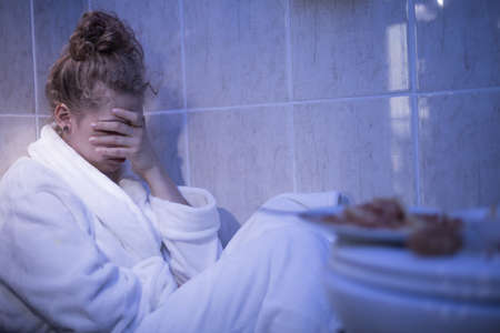 bathrobes: Bulimic girl feeling sick after hunger attack