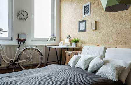 bedroom interior: White city bicycle in bedroom with wooden wall Stock Photo