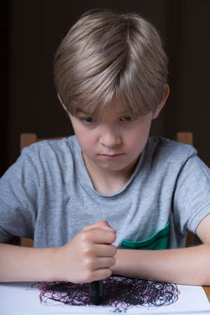 school boy: Vertical view of young boy having depression Stock Photo