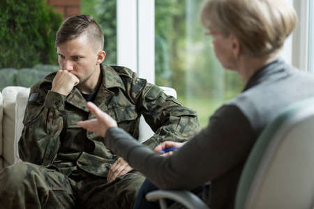 nervous: Image of male in army uniform during psychological session Stock Photo