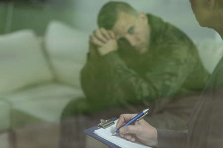 traumatic: Photo of young soldier with mental health problem