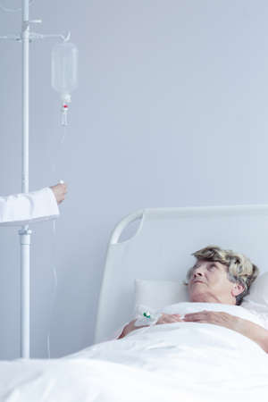 intravenous drip: Image of old patient lying with intravenous drip