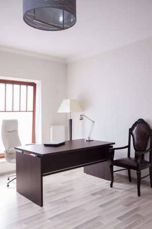 organized home: Sunny and practical office in the house Stock Photo