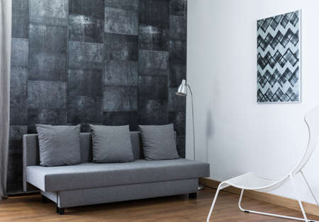 wall design: Image of stylish furnished living room with new wallpaper