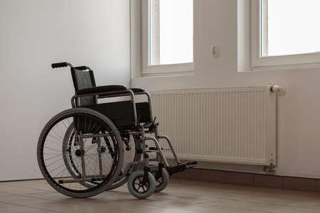 invalidity: Photo of empty wheelchair in hospital room Stock Photo