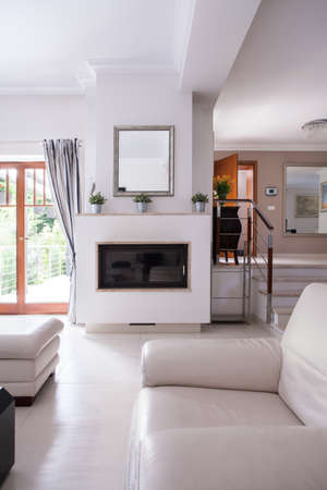 Light and modern living room with fireplace
