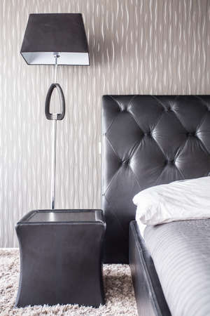 bedside: Bedside table and bed in the house