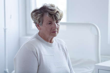 preoccupation: Close-up of senior female patient sitting in hospital