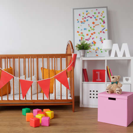 babygirl: Photo of stylish room for babygirl with wooden crib