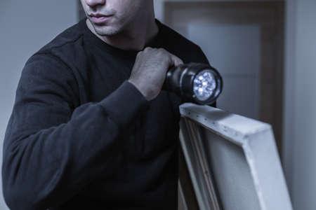 ladron: Foto de robo profesional de la imagen valiosa