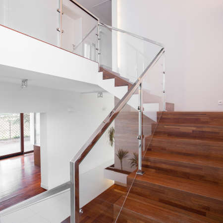 balustrade: Image of solid wooden stairs with elegant glass balustrade