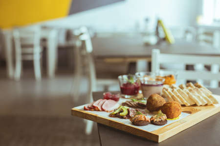 restaurant dining: Close-up of various tapas on wooden board