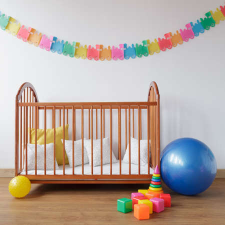 cosy: Picture of cosy baby room with simple bed