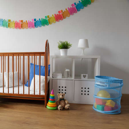 babyboy: Photo of simple design wooden cradle in cosy baby bedroom