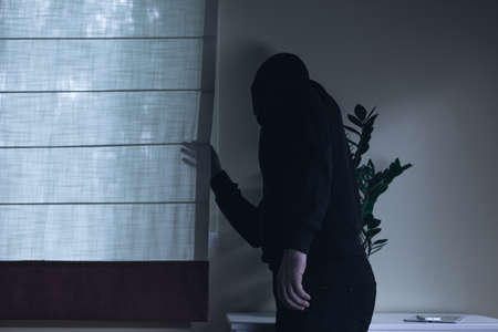 an invasion: Picture of masked housebreaker during night home invasion