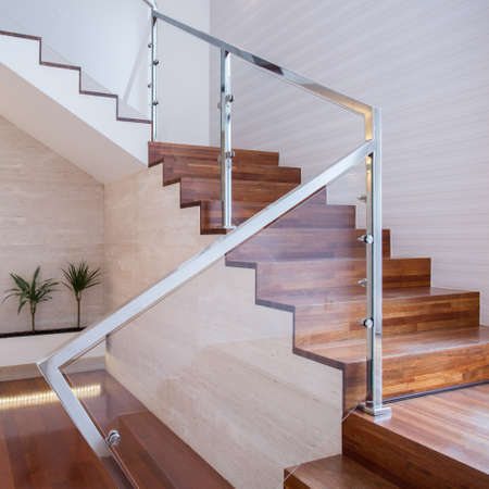 wooden railings: Image of stylish staircase in bright house interior