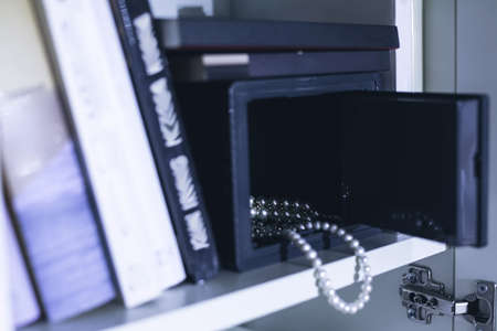 safe house: Image of open domestic safe with expensive jewellery Stock Photo