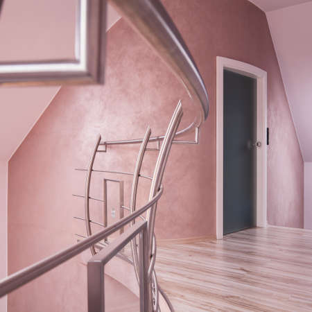 bannister: Hallway with a staircase in the house Stock Photo