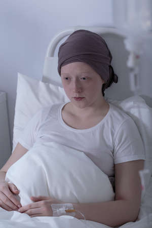 oncologist: Portrait of woeful girl with tumor in hospital