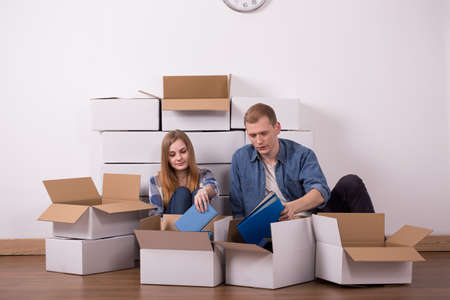 moving out: Photo of young married couple moving in new buyed apartment