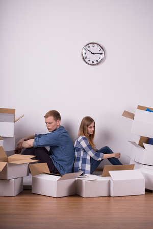 moving out: Image of couple tired of packing things during move
