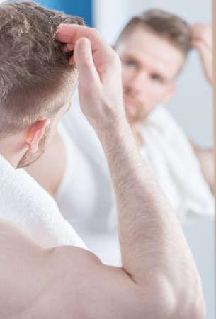 handsome men: Image of narcissistic man in the bathroom Archivio Fotografico