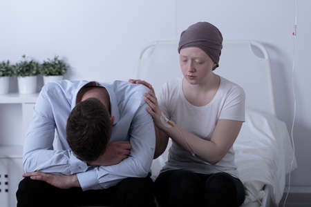 consoling: Picture of girl with cancer consoling her depressed dad