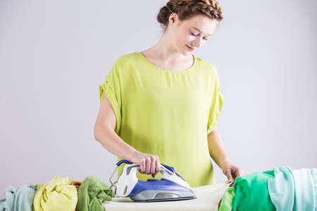 tidy: Photo of woman tidy pedantic ironing clothes