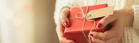 Girl holding red box of christmas present Stock Photo