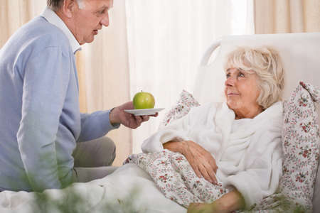 taking a wife: Loving husband taking care of his sick wife