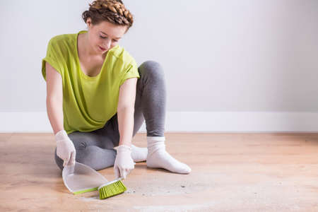 house maid: Image of beautiful private maid brooming apartment Stock Photo