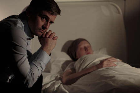 woeful: Photo of anxious father with his sleeping child with tumor Stock Photo
