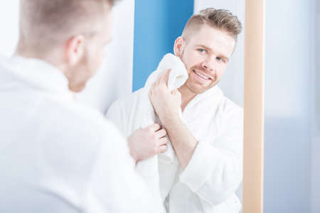 bath gown: Horizontal view of attractive man in bathroom