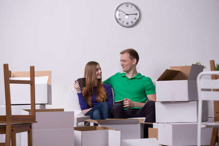 moving out: Photo of happy couple moving out to new house