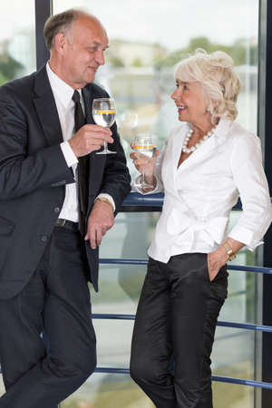 informal: Man and woman are talking at informal business party Stock Photo